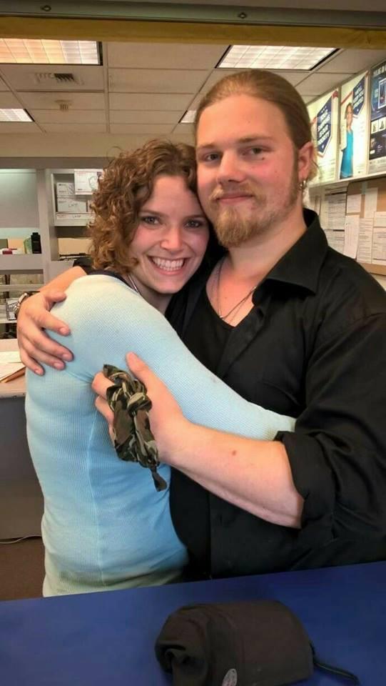 Noah Brown wrapping his fiancee, Rhian Alisha around his arms