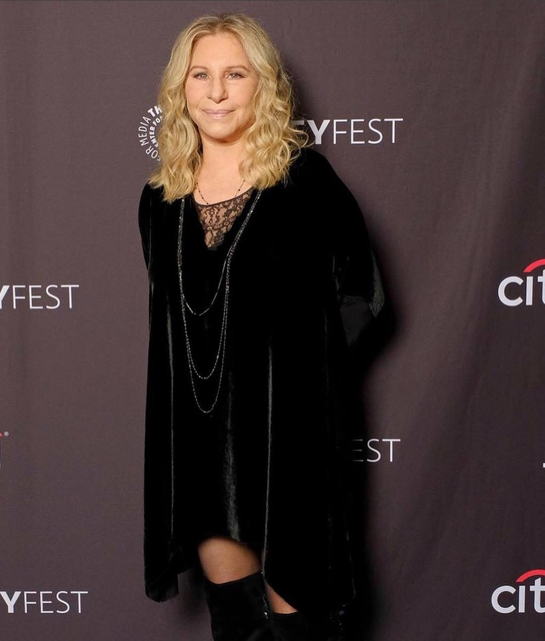 Barbra Streisand attending an event in a total black attire complimented by a neck piece
