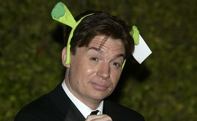 Mike Myers wearing the signature Shrek ears band on his head