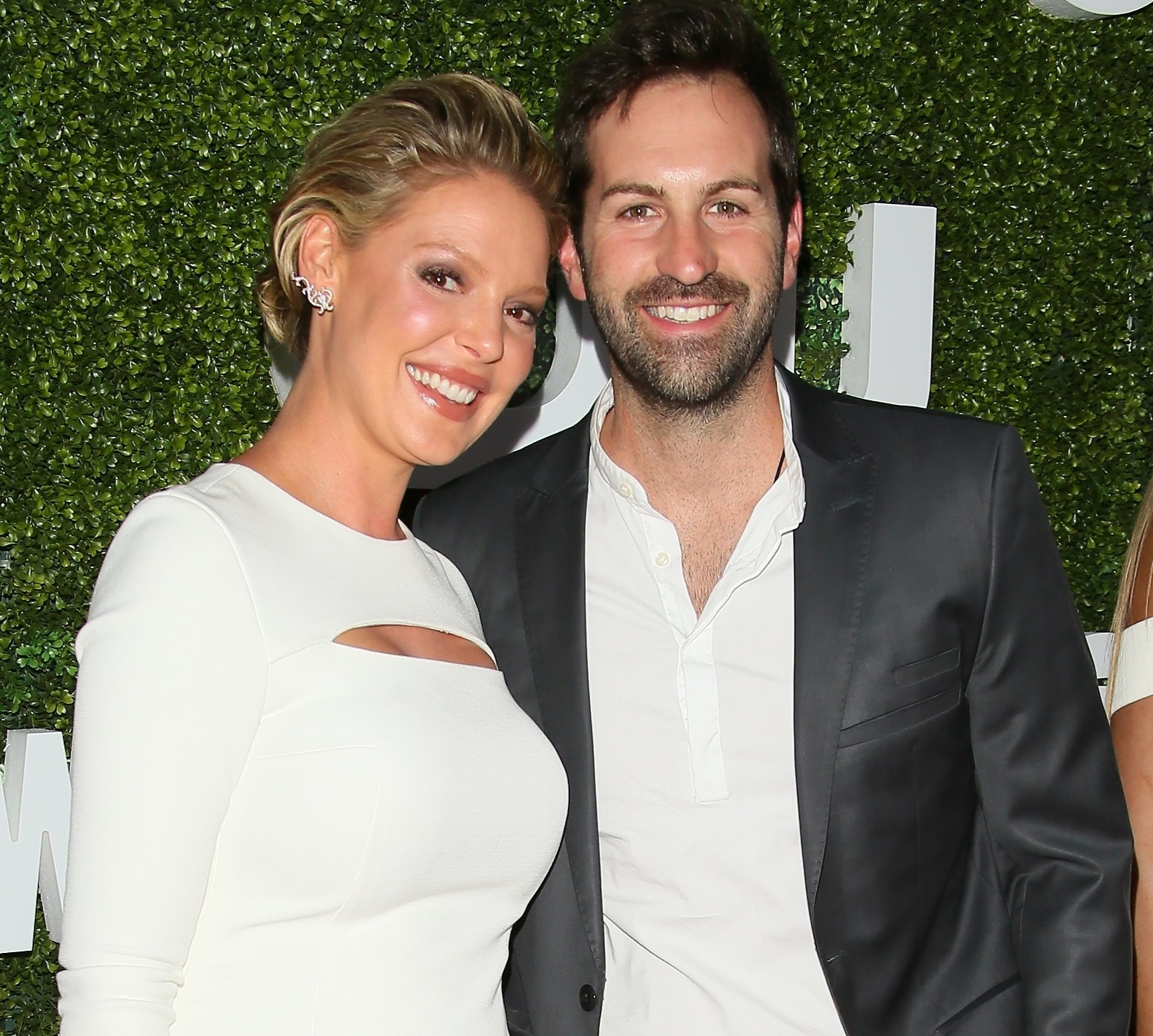 Katherine Heigl and Josh Kelley attending an event in all smiles