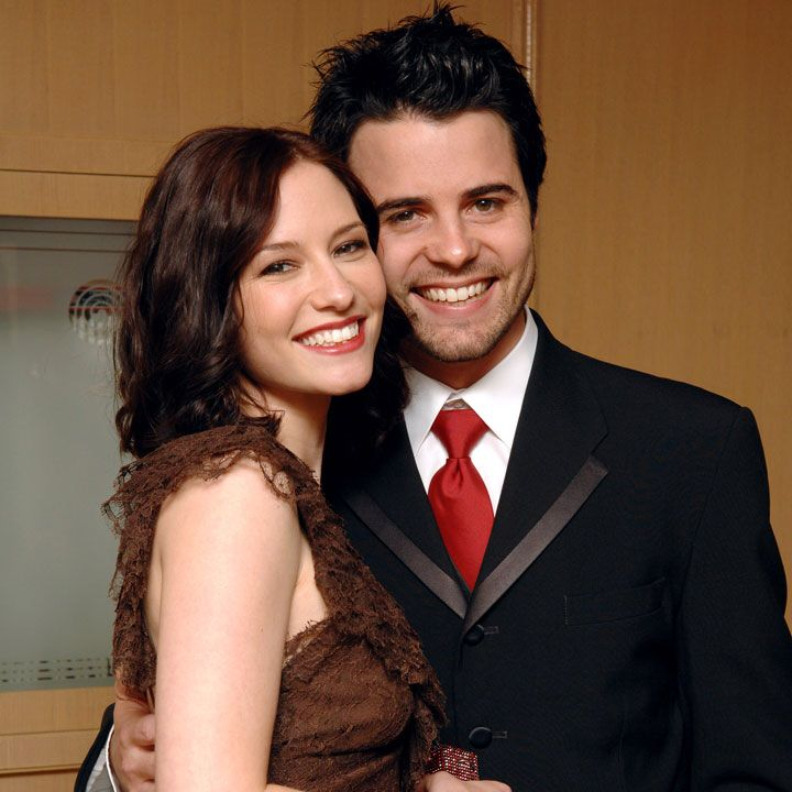 Nathan West wrapping his one hand around his wife, Chyler Leigh
