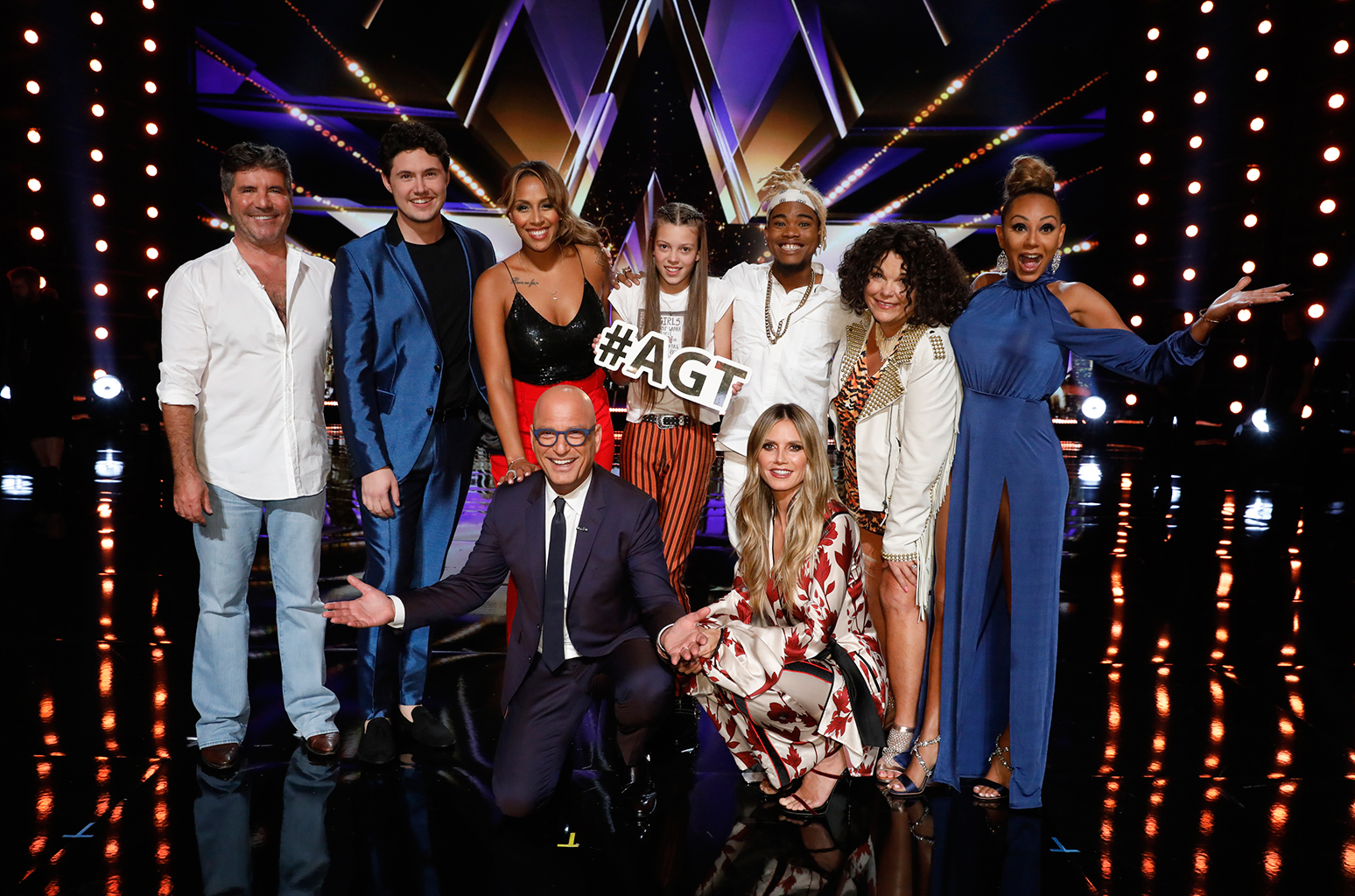 AGT finalists and judges posing for a picture