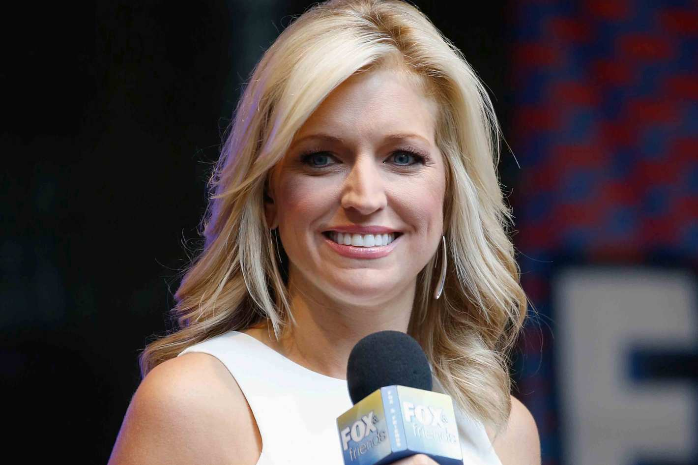 Ainsley Earhardt holding a microphone