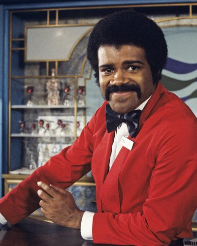 Ted Lange as Isaac Washington in The Love Boat. Apart from The Love Boat, he appeared in shows like, In the Heat of Night, Scrubs and General Hospital.
