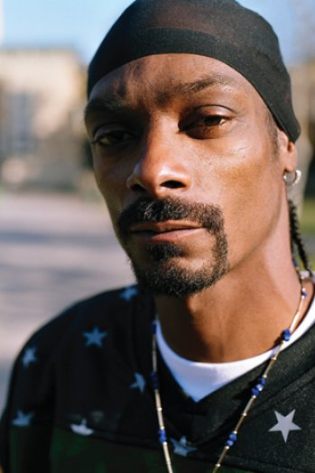 Front head-shot image of Snoop Dogg wearing a Do-rag. Besides involving in the Music Industry, Calvin Cordozar Broadus Jr aka Snoop Dogg has starred in the films Hot Boyz & Bones. Snoop Dogg has a net worth of $135 million