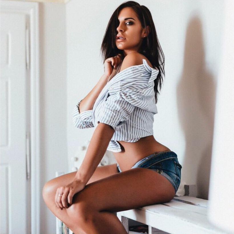 Jessica Shears sitting on a desk