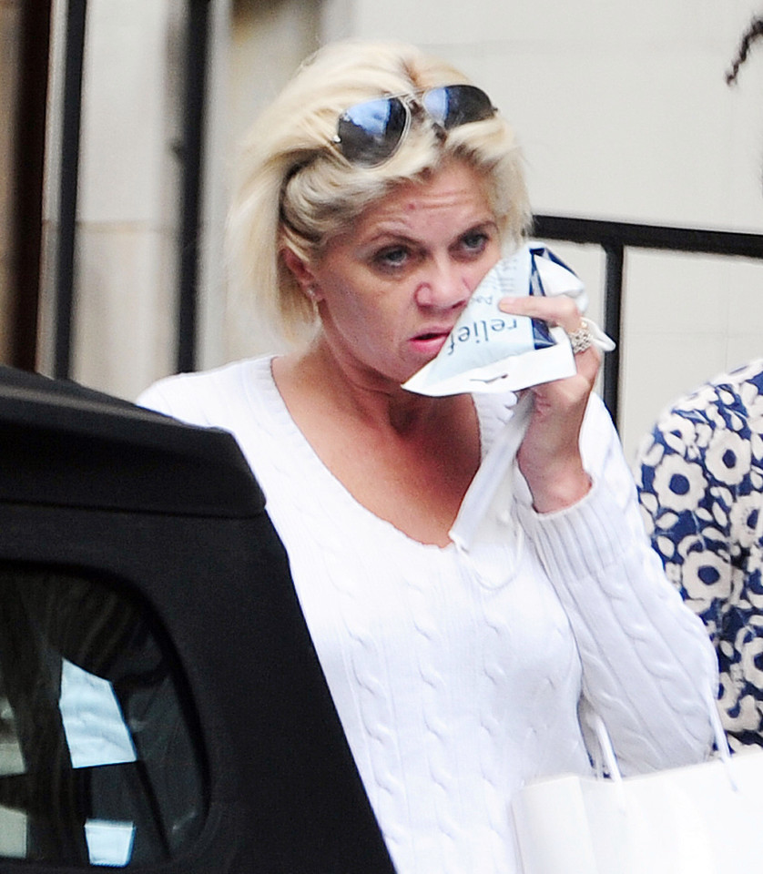 Danniella Westbrook holding an ice pack to her face after she stepped out of a clinic in 2016