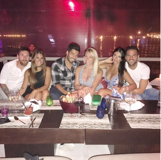 Lionel Messi, Luis Suarez and Cesc Fabregas with their respective better halves at a bar in Ibiza, Spain
