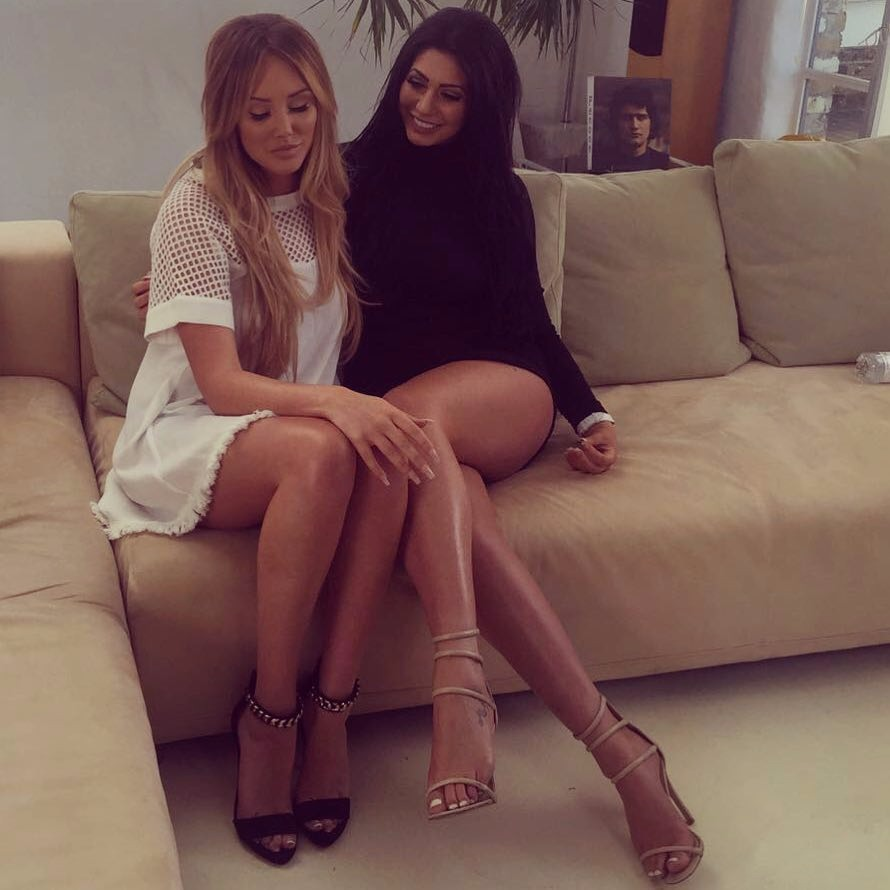 Chloe Ferry and Charlotte Crosby sitting cozily on a couch