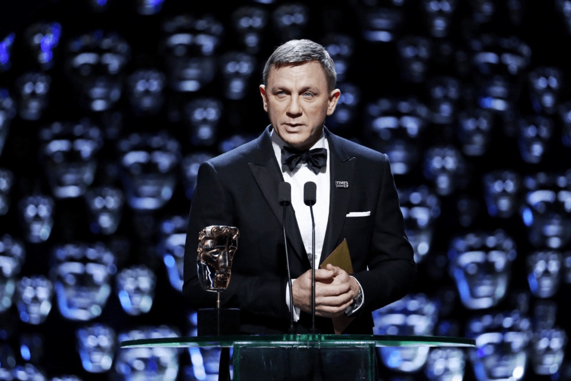 Daniel Craig on the stage of 71st British Academy Film Awards.