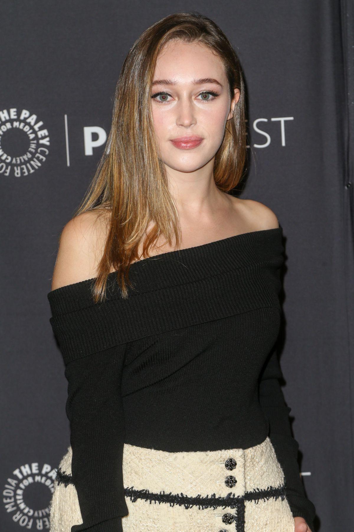 Alycia Debnam-Carey in a black top facing the camera.