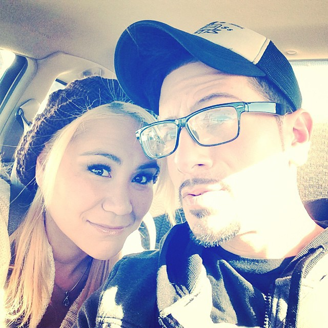 Miki Sudo in a car with her ex-boyfriend Juan Rodriguez. She's leaning close to him for a selfie.
