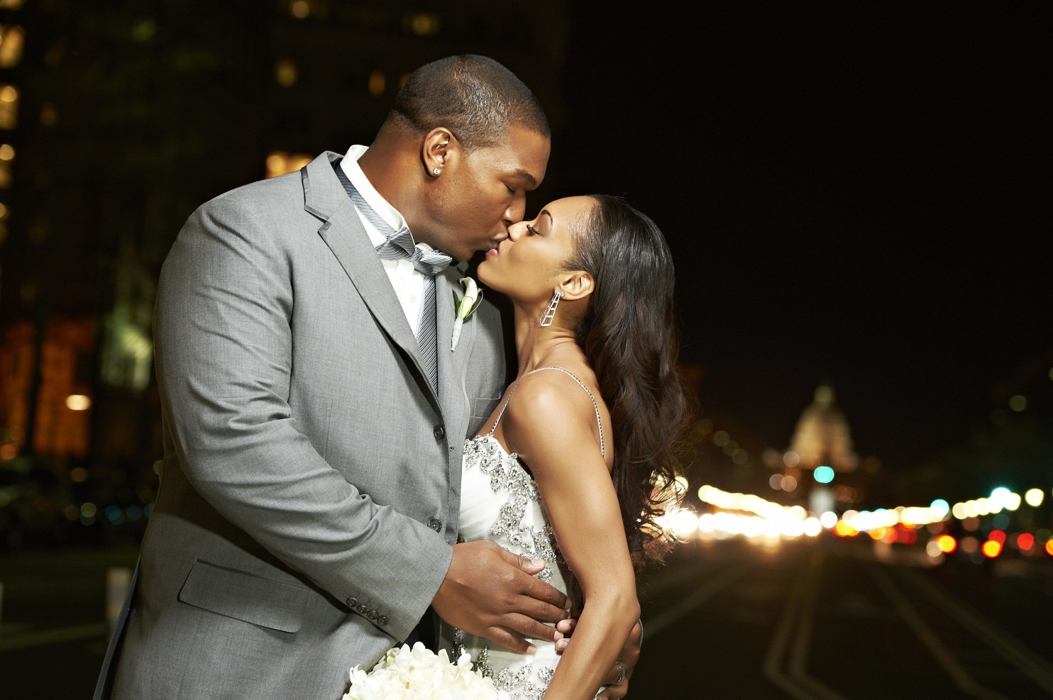 Chris Samuels holds Monique as he wraps his hands around her hips. They are kissing in the picture .