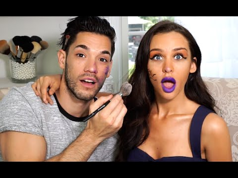 Carli Bybel has her mouth open and hugs Brett Cap while Brett is holding a makeup tool