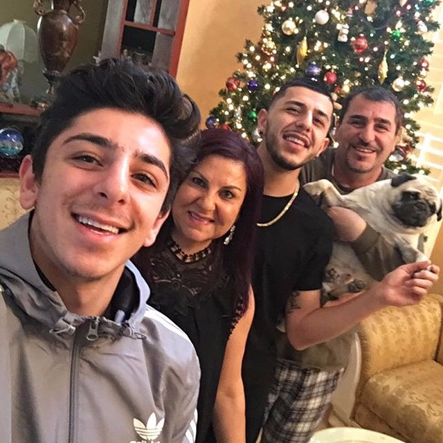 The photo features FaZe Rug, Mama Rug, Brawadis (Rug's brother) and Papa Rug (from left to right)