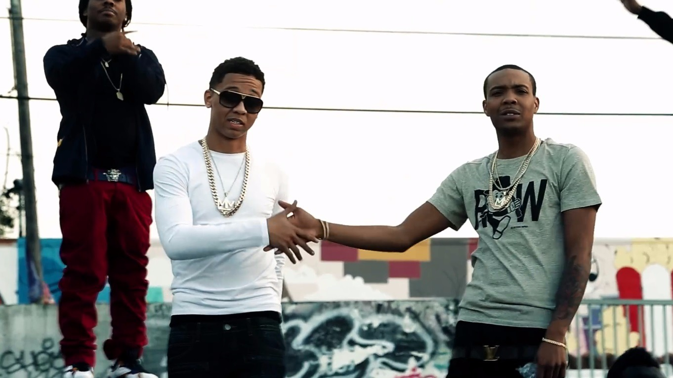 G Herbo and Lil Bibby shaking hands. They started their career collaboratively in 2010.