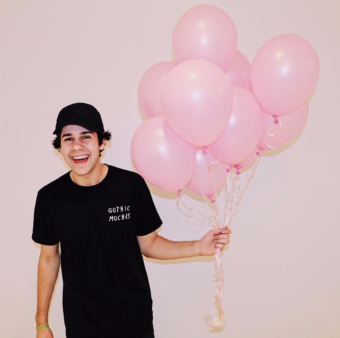 David Dobrik holding multiple balloons