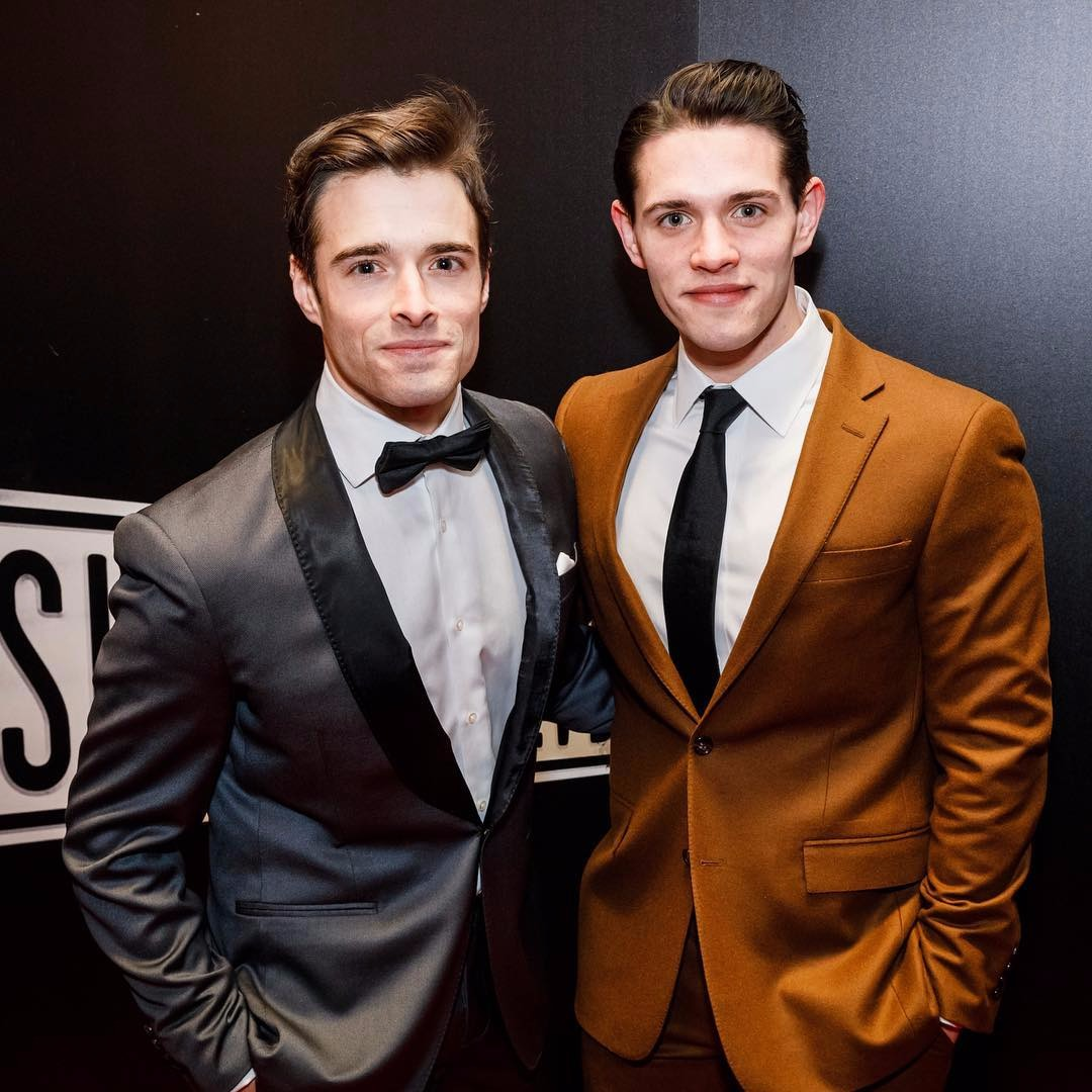 Casey Cott with brother Corey Cott, both of them are wearing suits