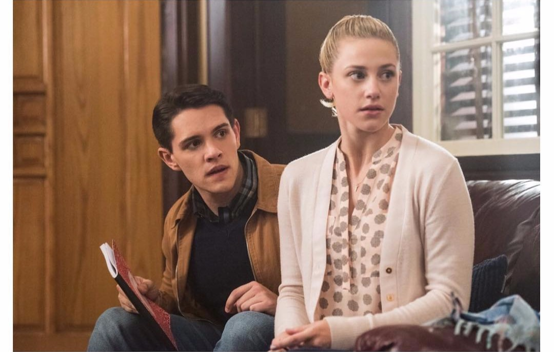 A still from Riverdale featuring Casey Cott and Lili Reinhart as Kevin Keller and Betty Cooper