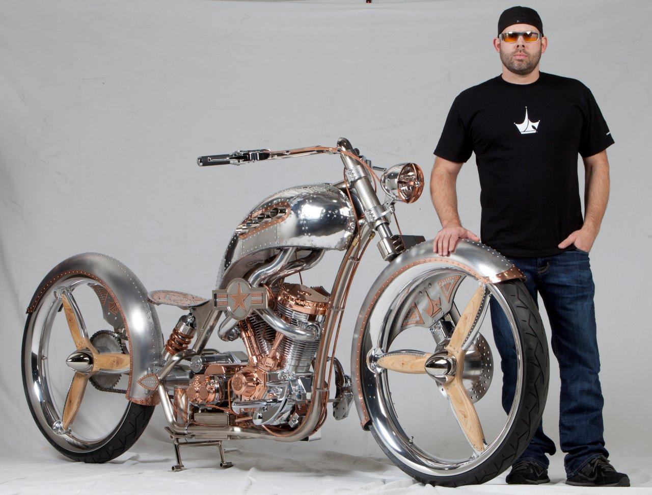 Paul Teutul standing infront of a custom made bike