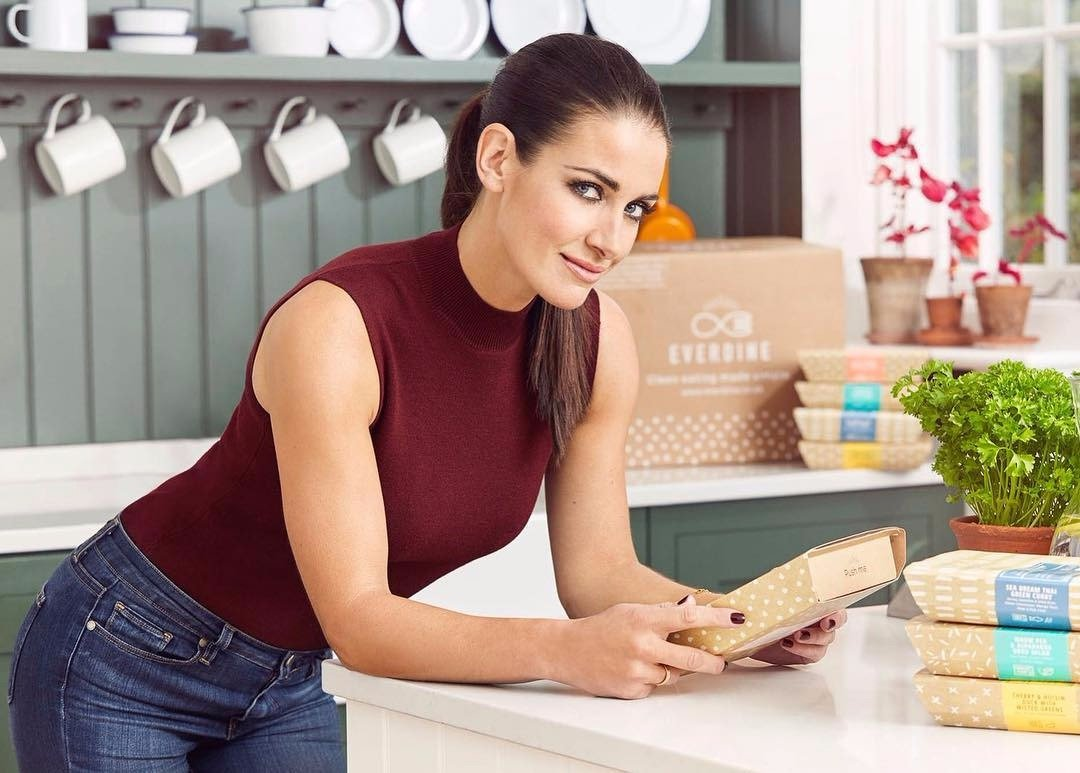 Kirsty Gallacher leaning on a table supporting her elbow