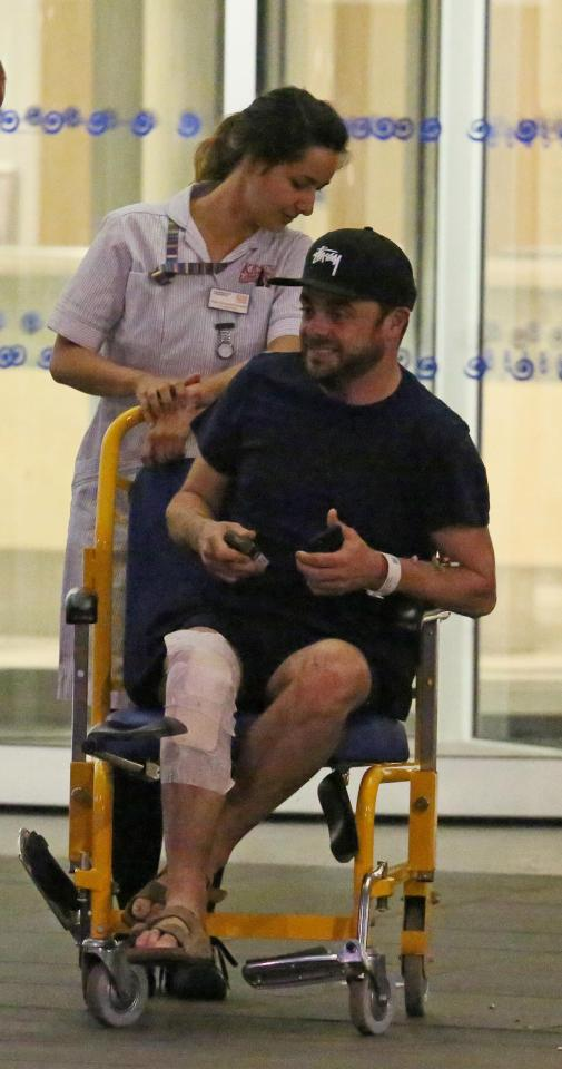 Ant McPartlin being moved in wheelchair after his surgery for knee pain