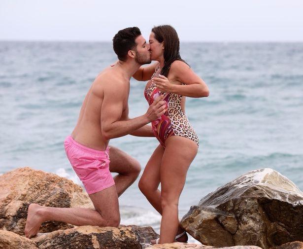 Karen Danczuk and boyfriend David kiss after getting engaged at a Spanish beach