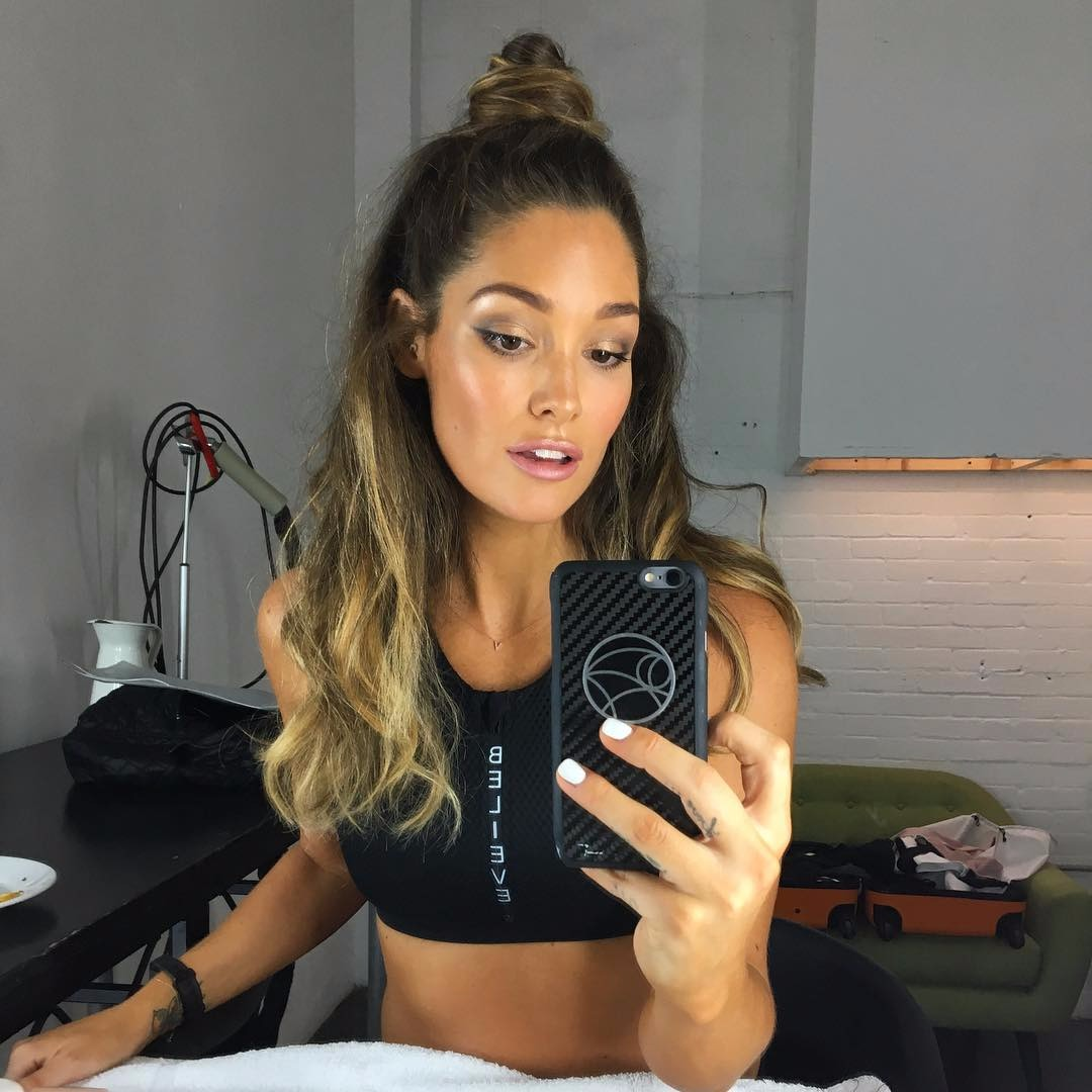 Model Erin McNaught takes a mirror selfie during her workout photo-shoot