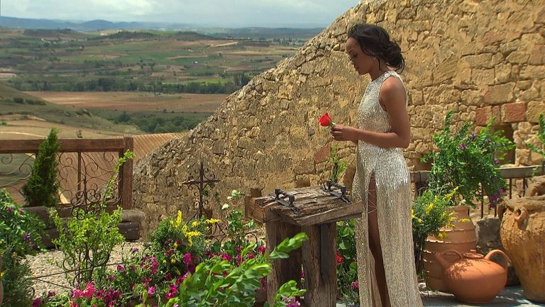 Rachel Lindsay is waiting for Bryan Abasolo to give him her final rose at the proposal site in Spain