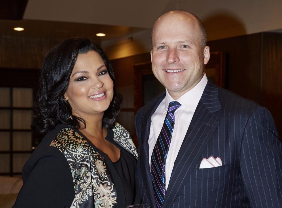 Sukanya Krishnan standing next to husband Eric Schroeder