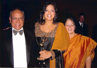 Sukanya Krishnan celebrating her Emmy win with her parents