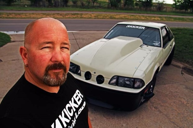 Chuck Seitsinger taking a selfie with the Death Trap in the background