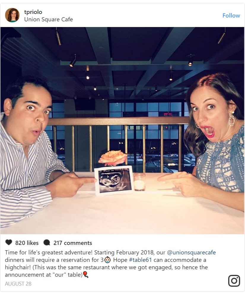 Teresa Priolo and her husband sitting opposite each other at a table, there's a sonogram of their first baby on the table