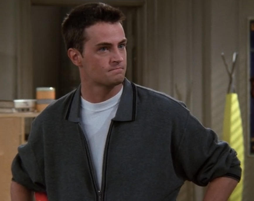 Matthew Perry is biting his lips with a serious look