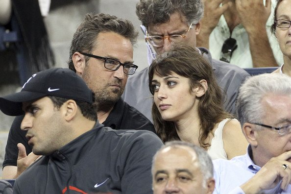 Matthew Perry and his then-girlfriend, Lizzy Caplan in the stadium for the US open