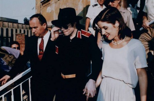 Lisa Marie Presley with Micheal Jackson, Budapest, 1994. They are holding hands while greeted by thousands of fans.