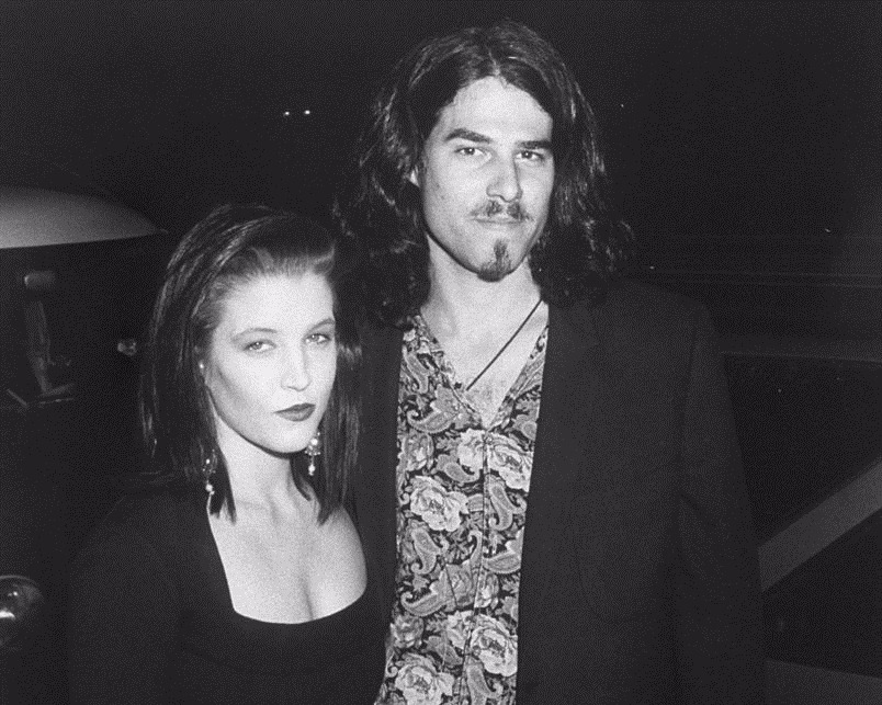 Black and white image of Lisa Marie Presley and her spouse Danny Keough. Both Lisa Marie Presley and Danny Keough have bob hair cut.