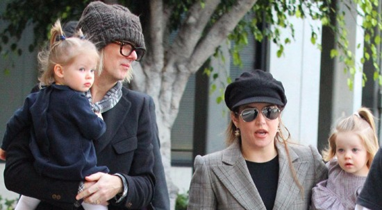 Lisa Marie Presley and Michael Lockwood talking a walk with their twin daughters.