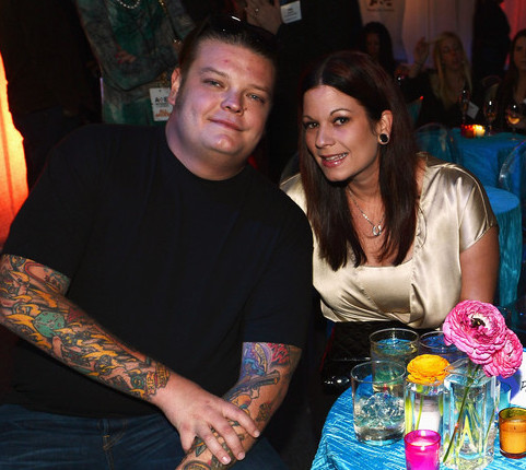 Corey Harrison is sitting on a chair leaning towards his ex-wife, Charlene