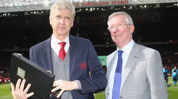Ferguson giving Wenger a commemorative trophy.