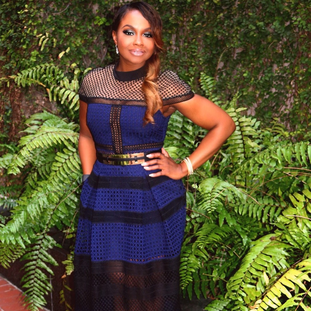 Phaedra Parks posing in the blue dress bordered with black color. She is the star of the Real Housewives of Atlanta.