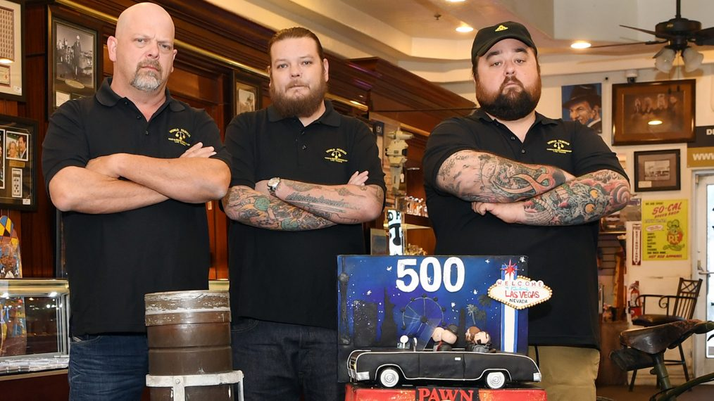 Rick Harrison, Corey Harrison and Chumlee are standing with their hands folded wearing matching back t-shirt