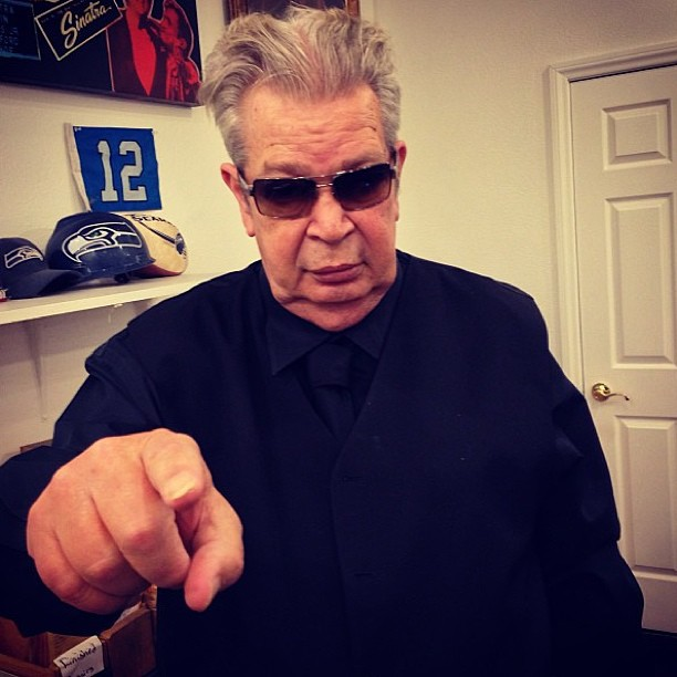 "Richard ""Old Man"" Harrison is wearing sun-glass and pointing with his index finger"