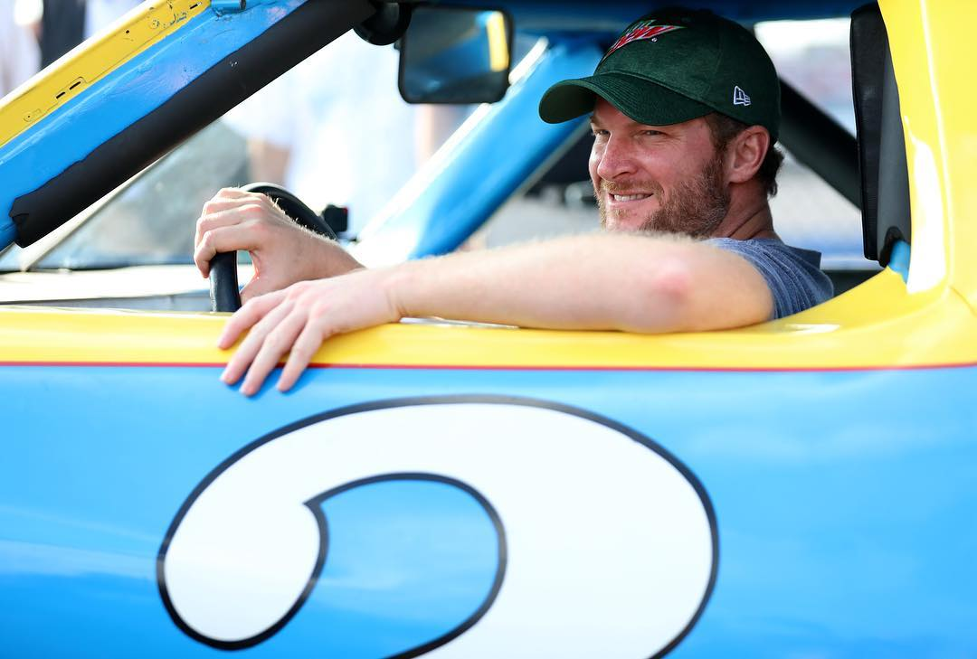 Dale Earnhardt Jr. sitting in his car with a smile on his face