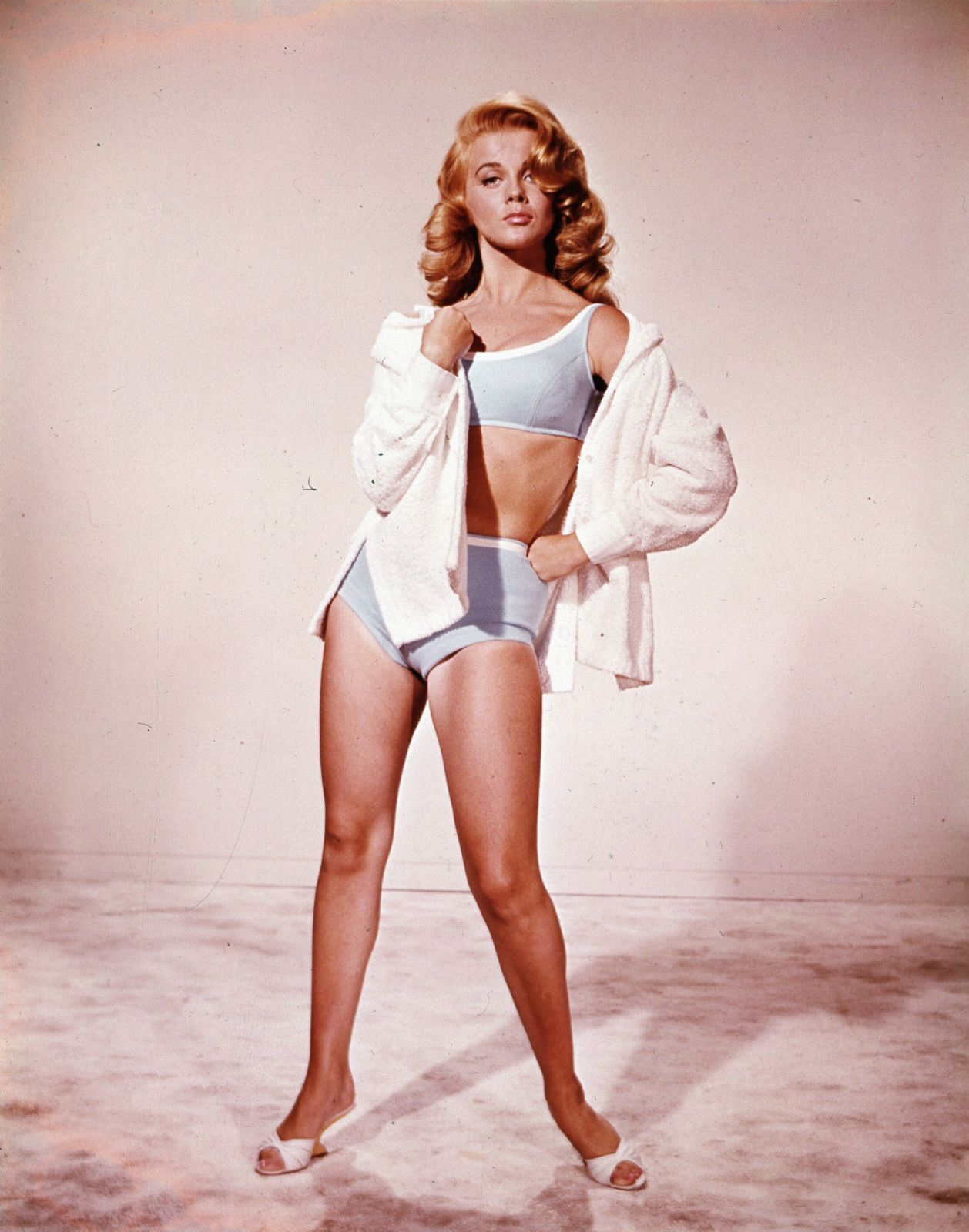 Ann Margret is flaunting her body in bikini wearing a only shirt.