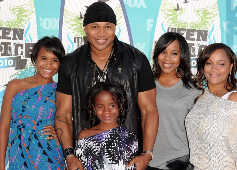 LL Cool J is with his wife and three daughters. They are smiling at the camera.