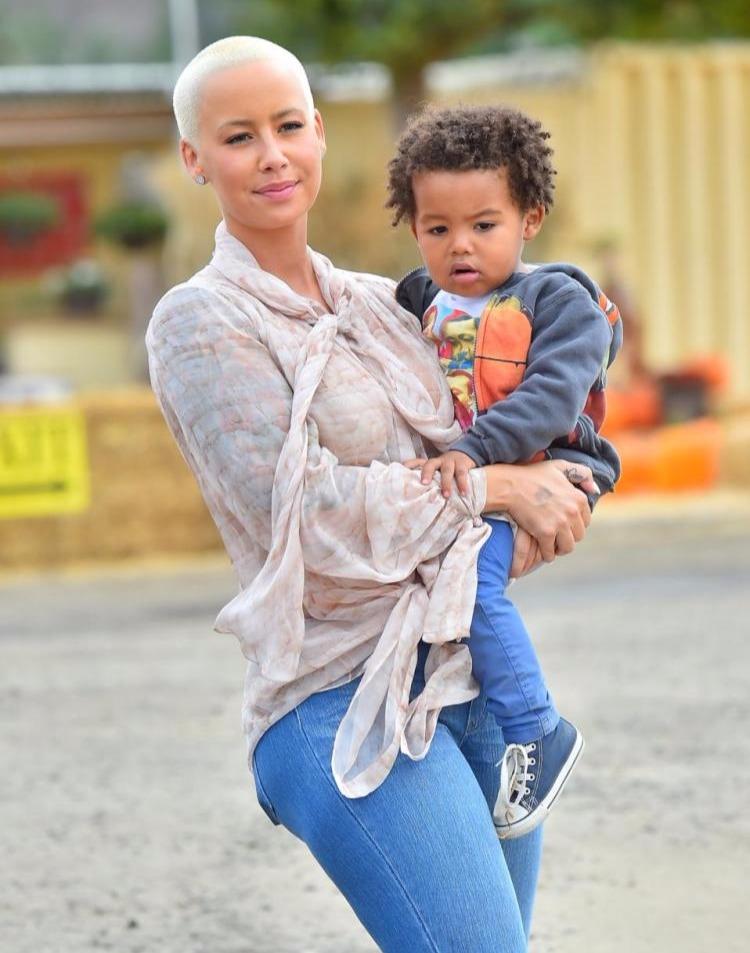 Amber Rose holding her son Sebastian
