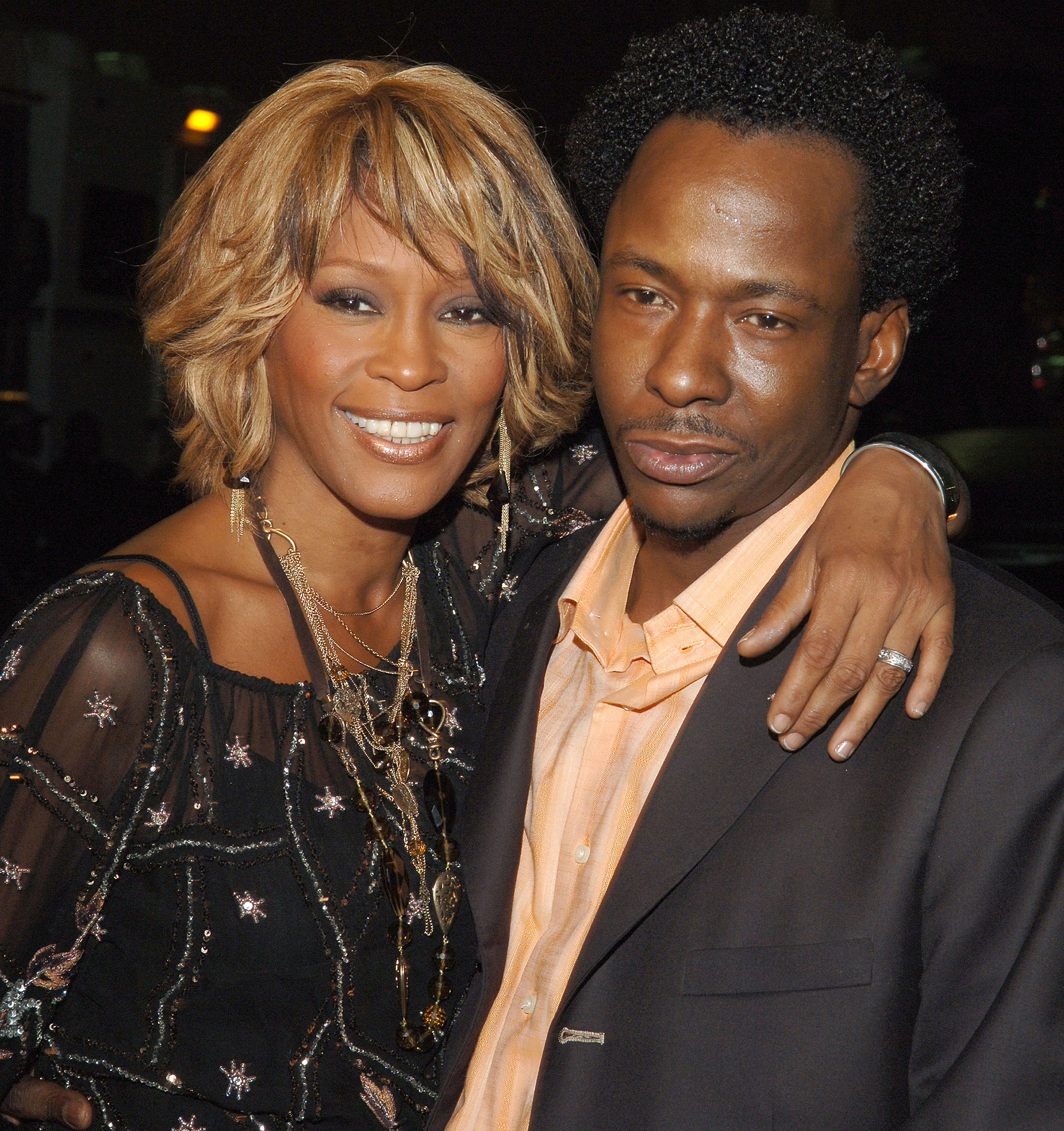Whitney Houston and Bobby Brown posing for a picture together