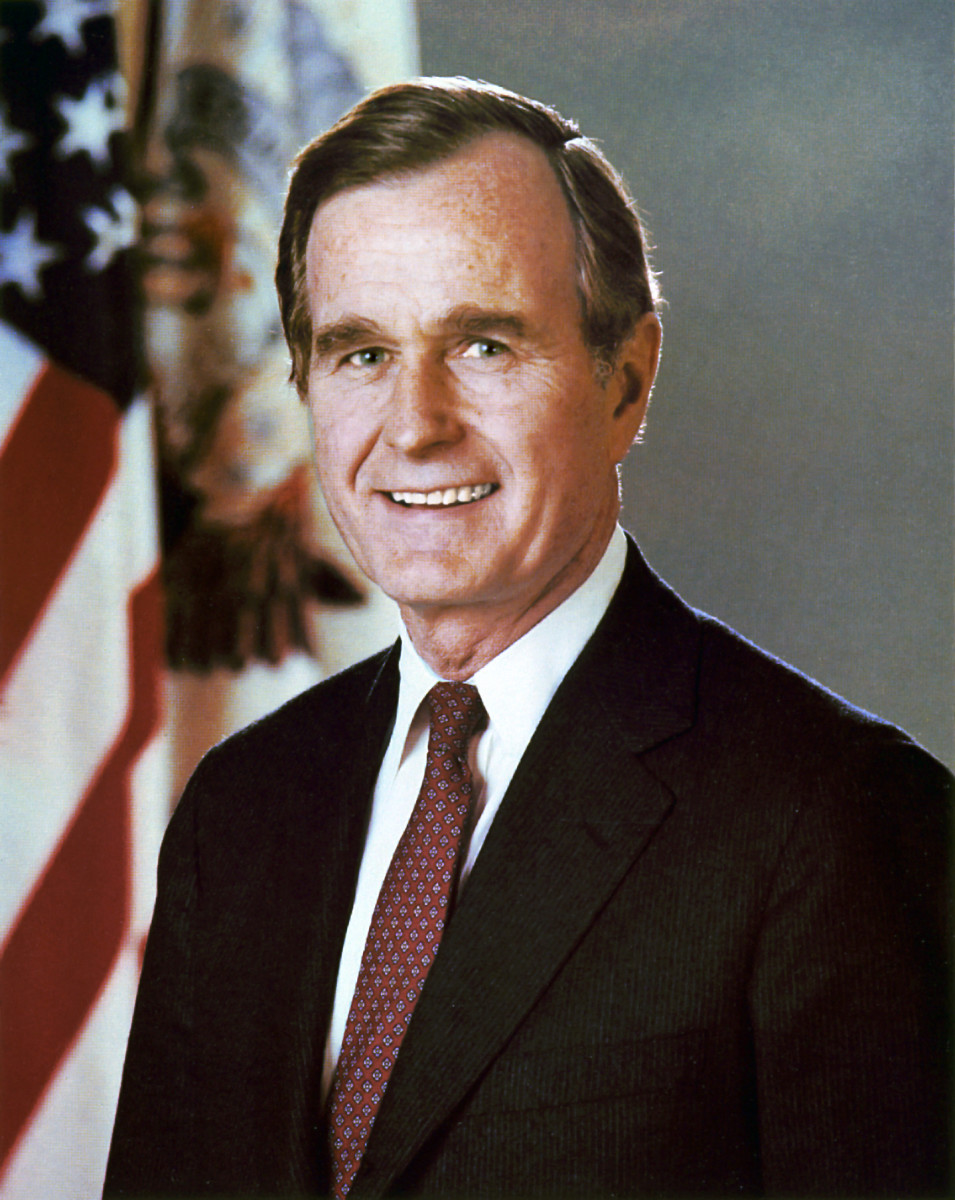 George H.W Bush smiling for a picture