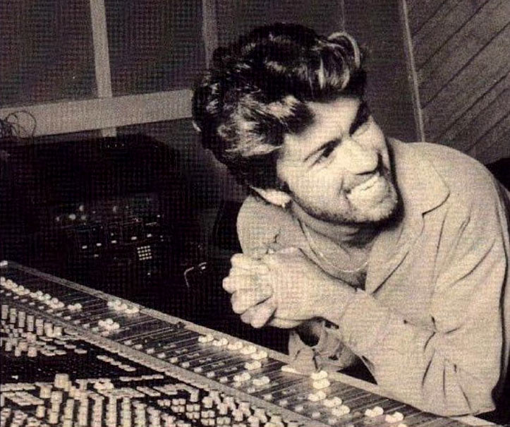 George smiling in a studio